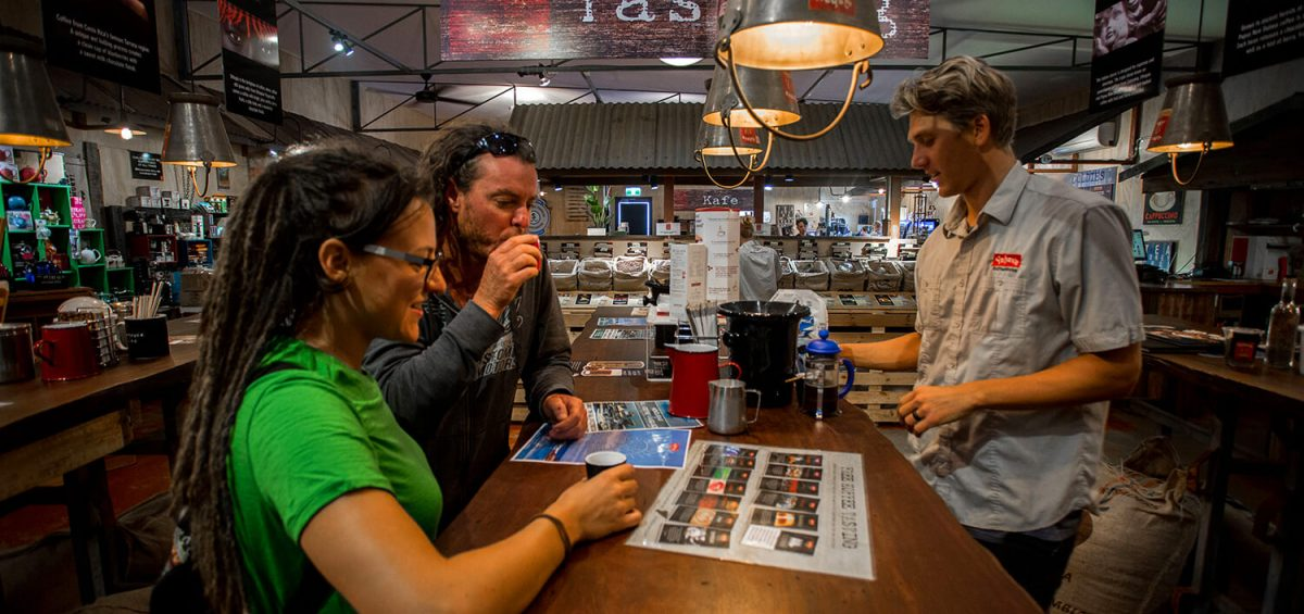 Guests sipping free coffee tastings at Yahava Koffee Academy