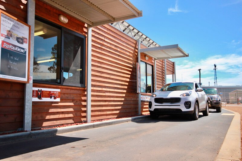 Cars ordering up at a Yahava Kwik Koffee (coffee drive thru) in Perth