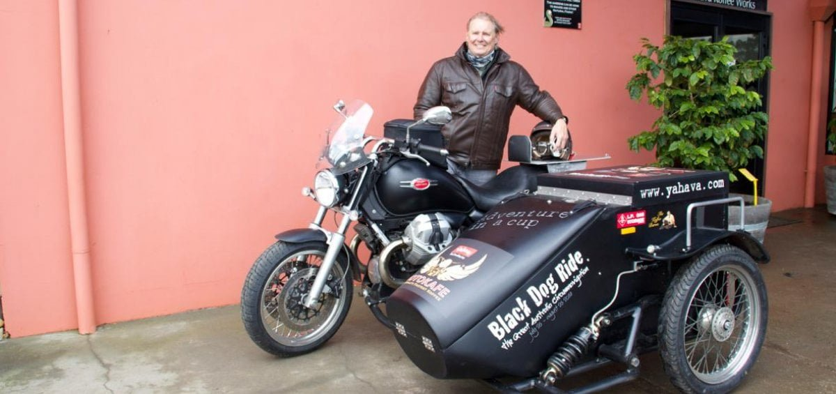 Man with Motorbike and sidecart used for the Yahava MotoKafe Project