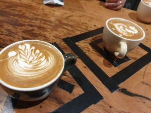 cups of coffee with various foam latte art