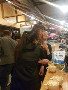 women hugging after successfully making latte foam art