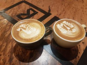 2 cups of coffee with latte art