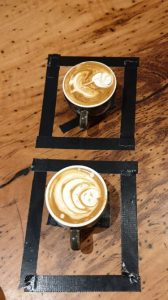 cups of coffee with flower and moon latte art