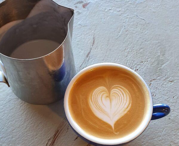 Deliciously poured flat white coffee with silky milk and latte art. Learn how to brew Perth's best coffee with Yahava.