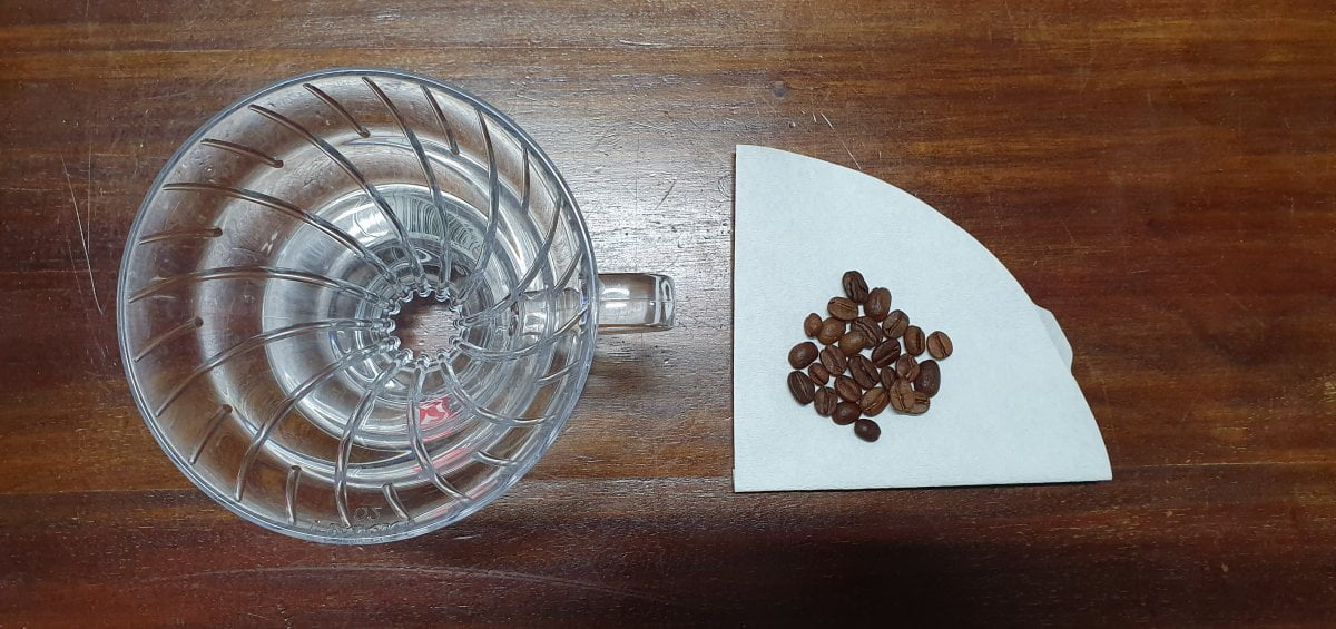 Filter paper & coffee beans. Learn how to brew filter coffee with Yahava.